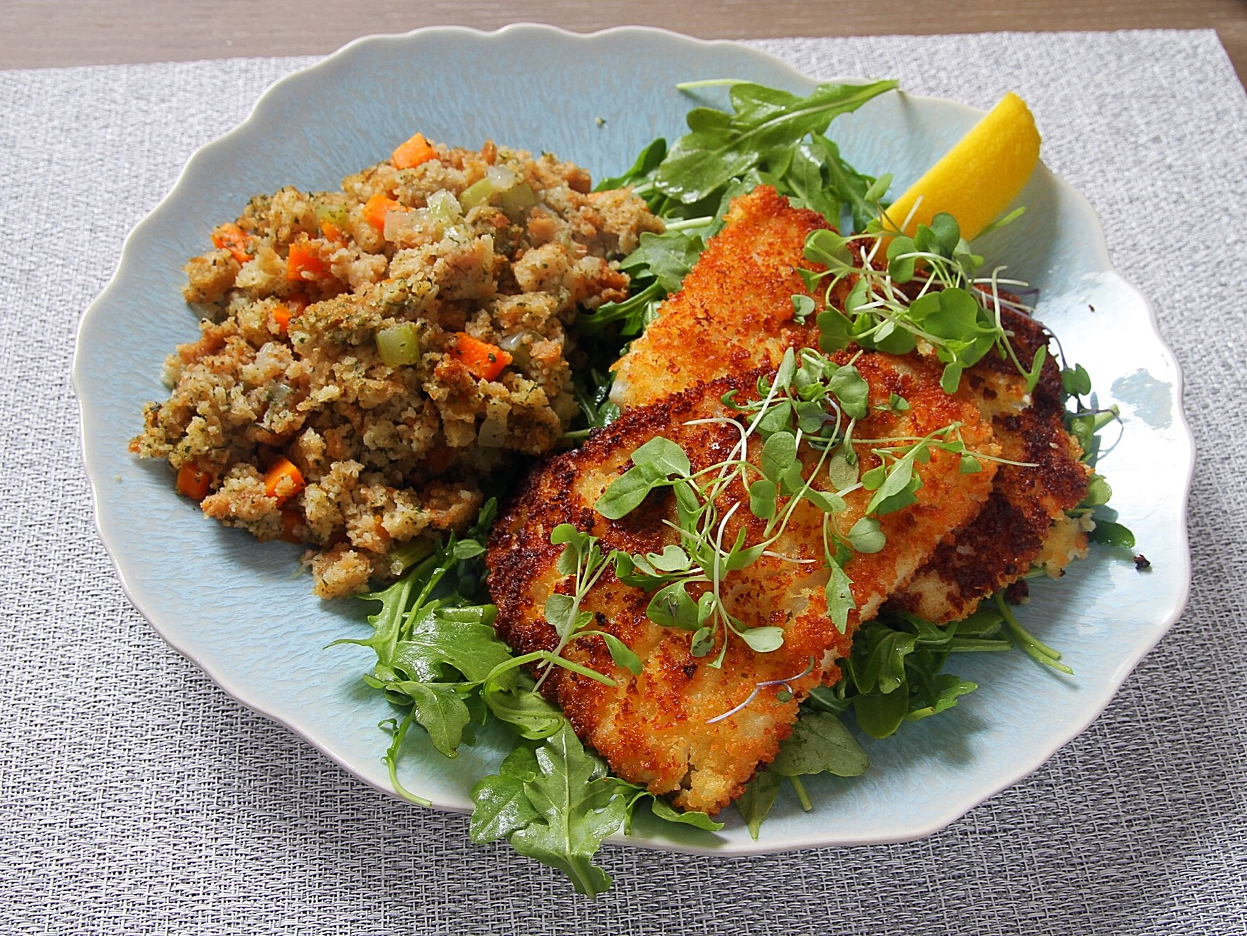 Panko-fried cod with GF savory stuffing from Aleia's Artisan Foods, served over arugula salad.