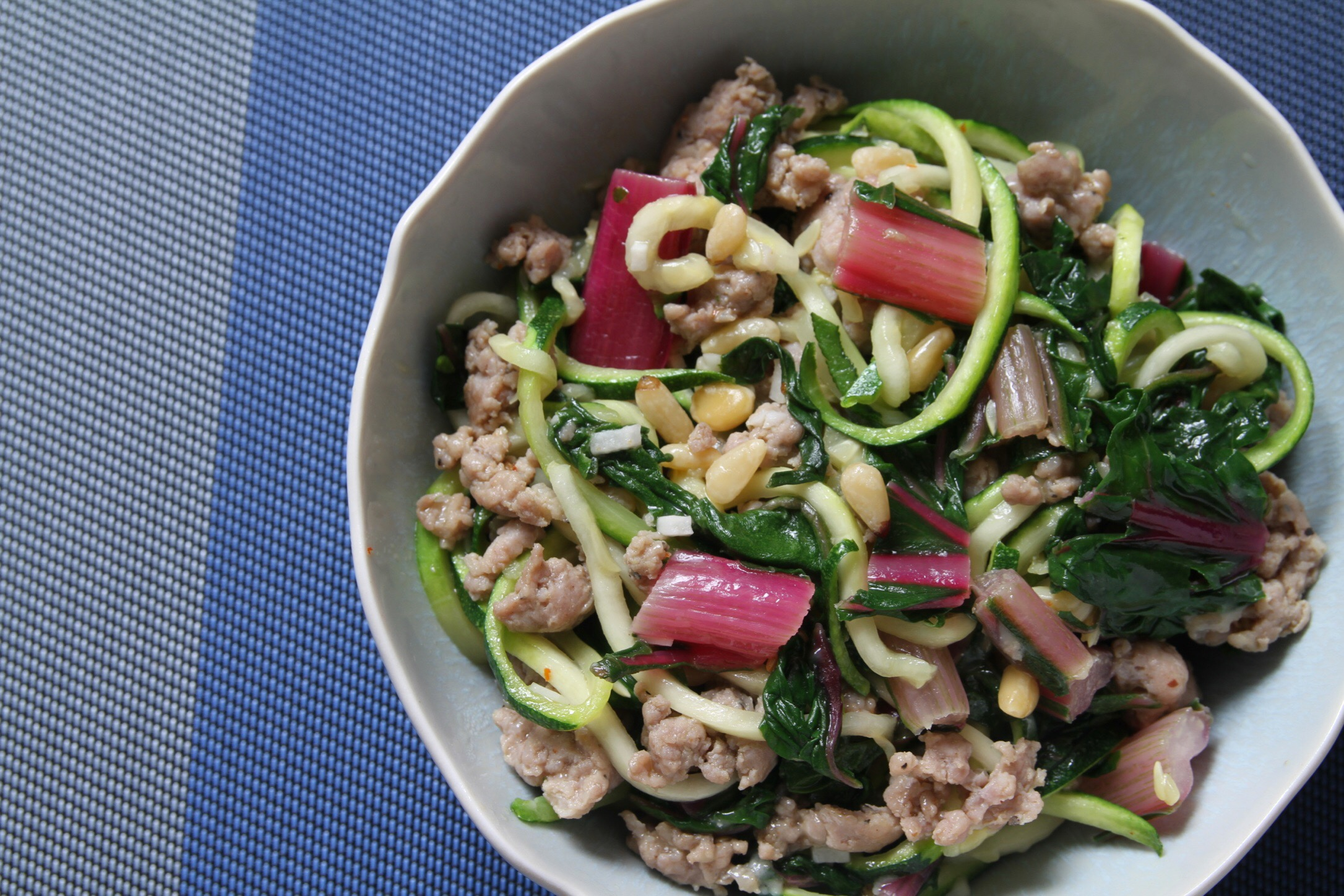 Zucchini noodles with sweet Italian sausage, chard, and pine nuts. And Parmesan!