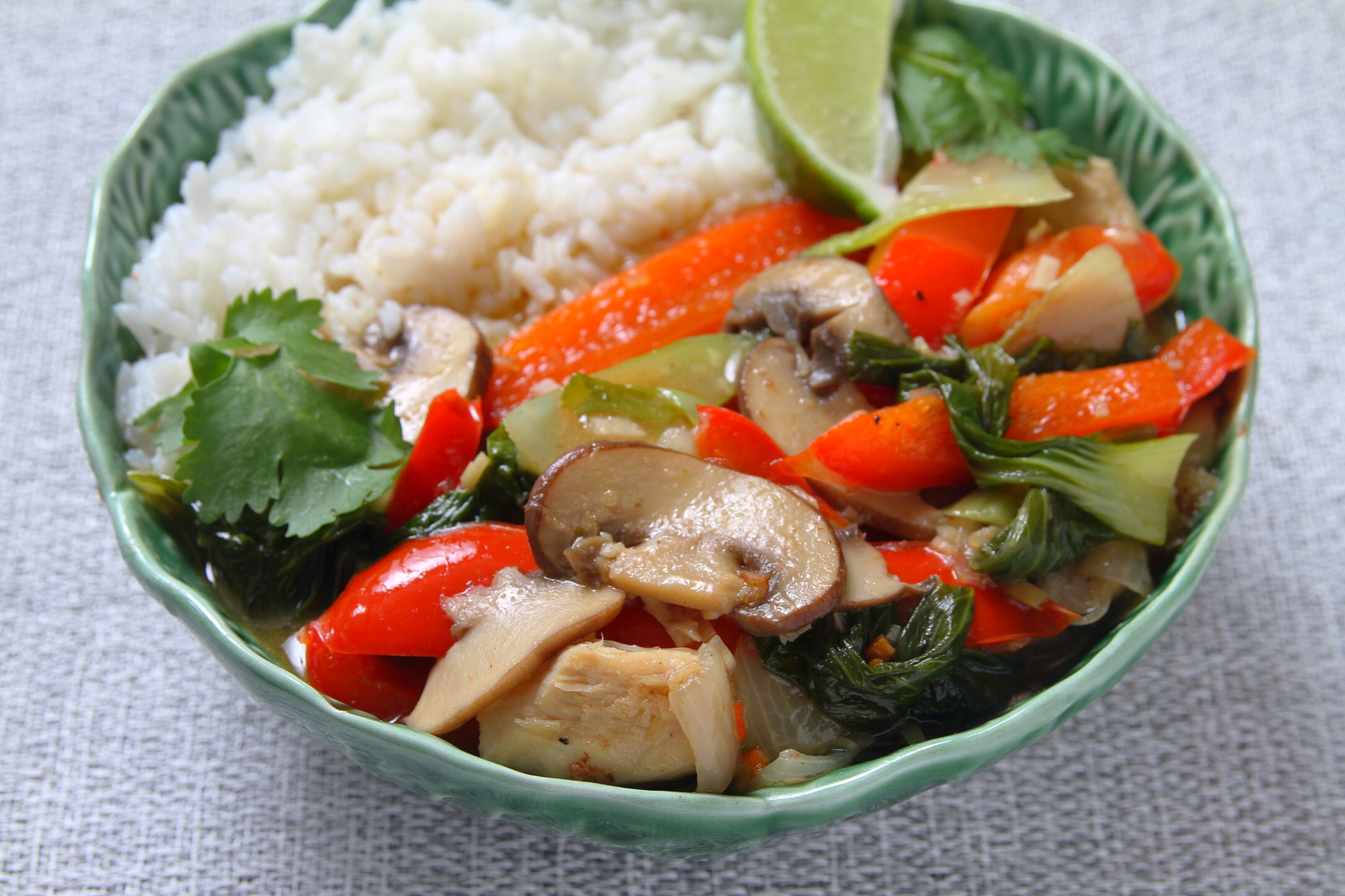Coconut curry with chicken and vegetables. Recipe from  Cherry Bombe The Cookbook.  Served with jasmine rice and lime wedge.