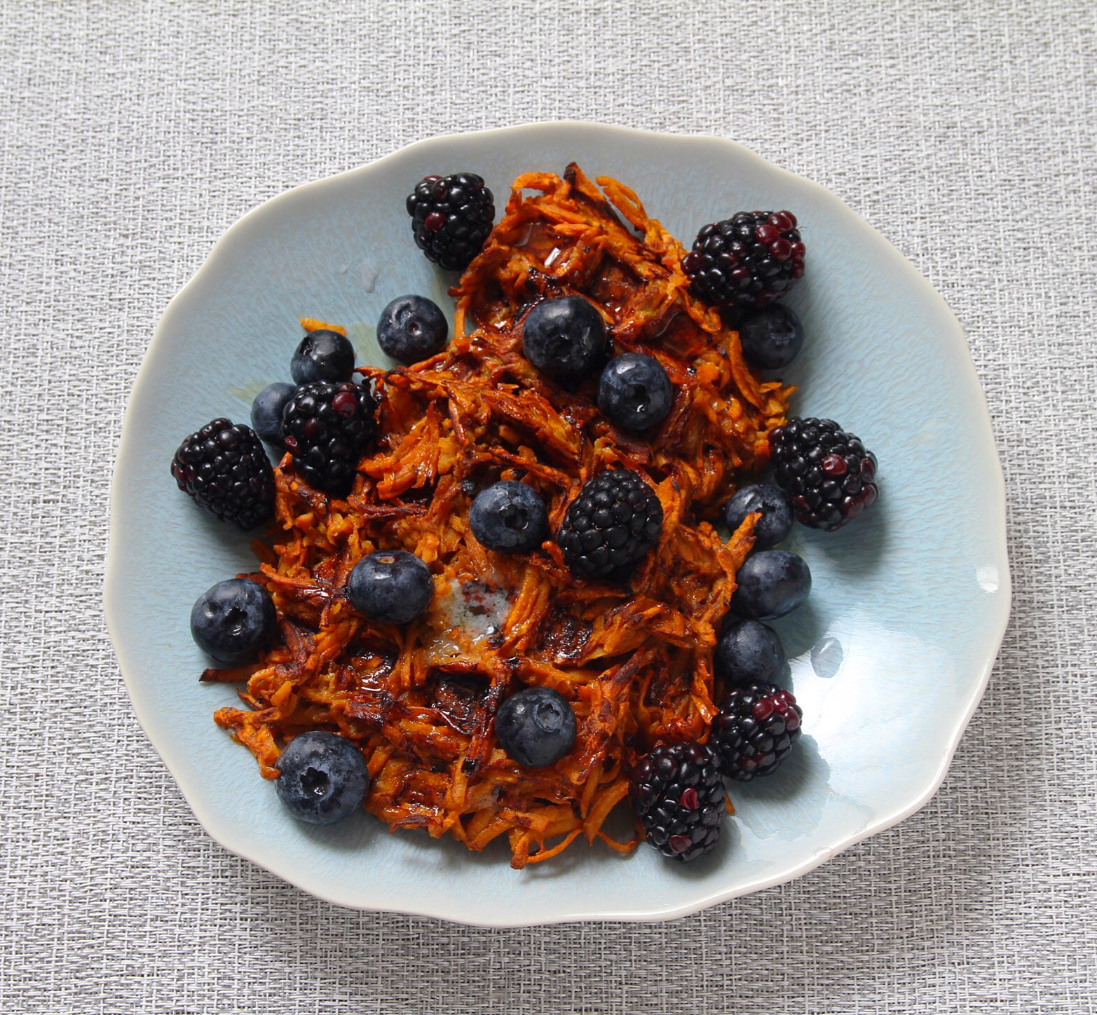 Sweet potato waffles with blueberries and blackberries. Syrup required!