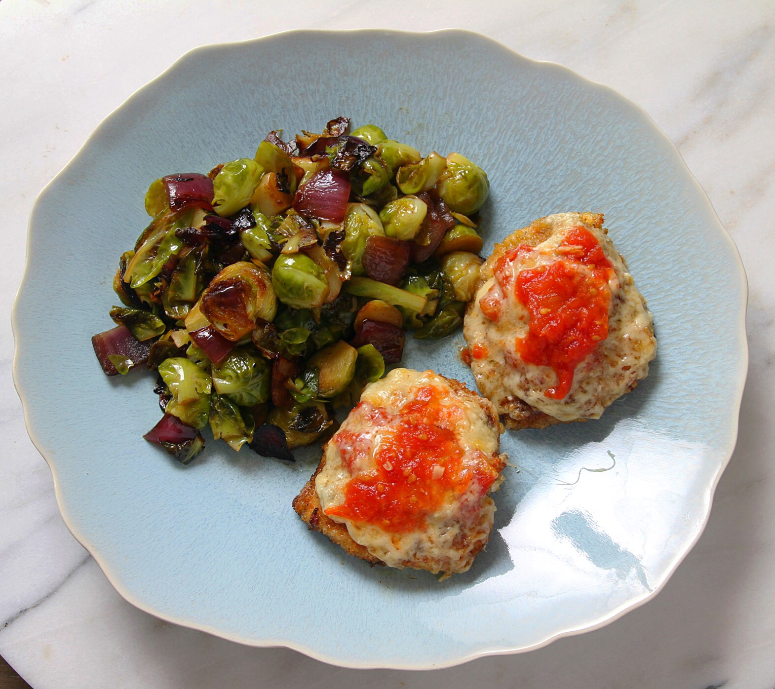 Brussels sprouts with homemade chicken Parmesan. An odd, but uniquely delicious, pairing.