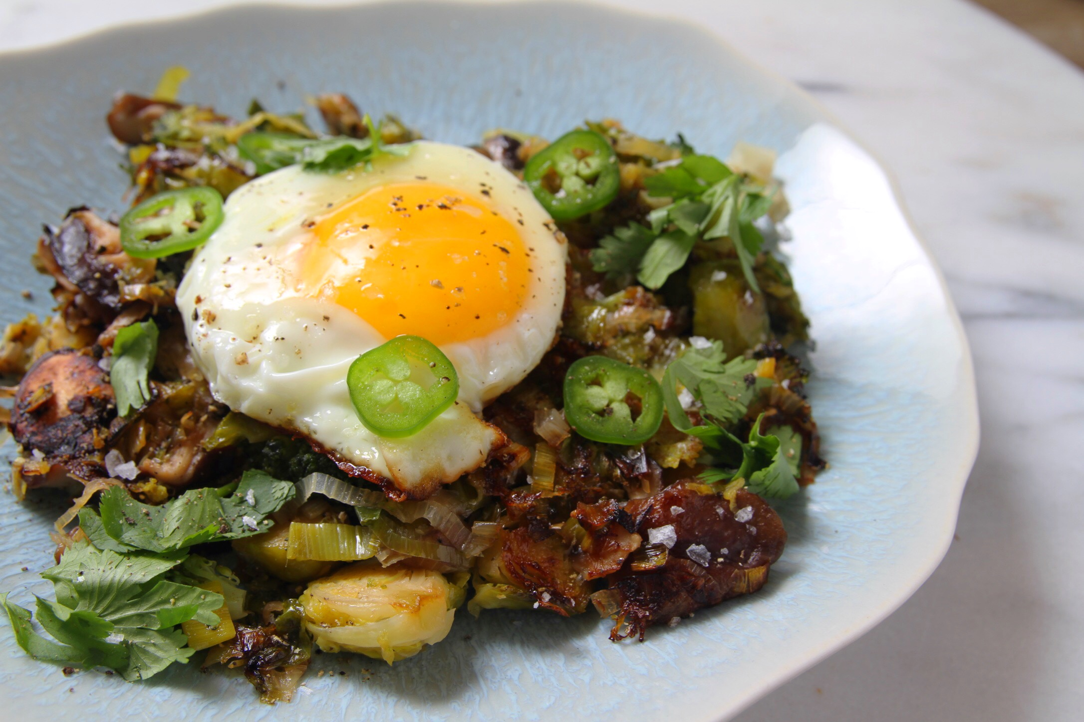 Winter vegetable hash with jalapeños and fried eggs