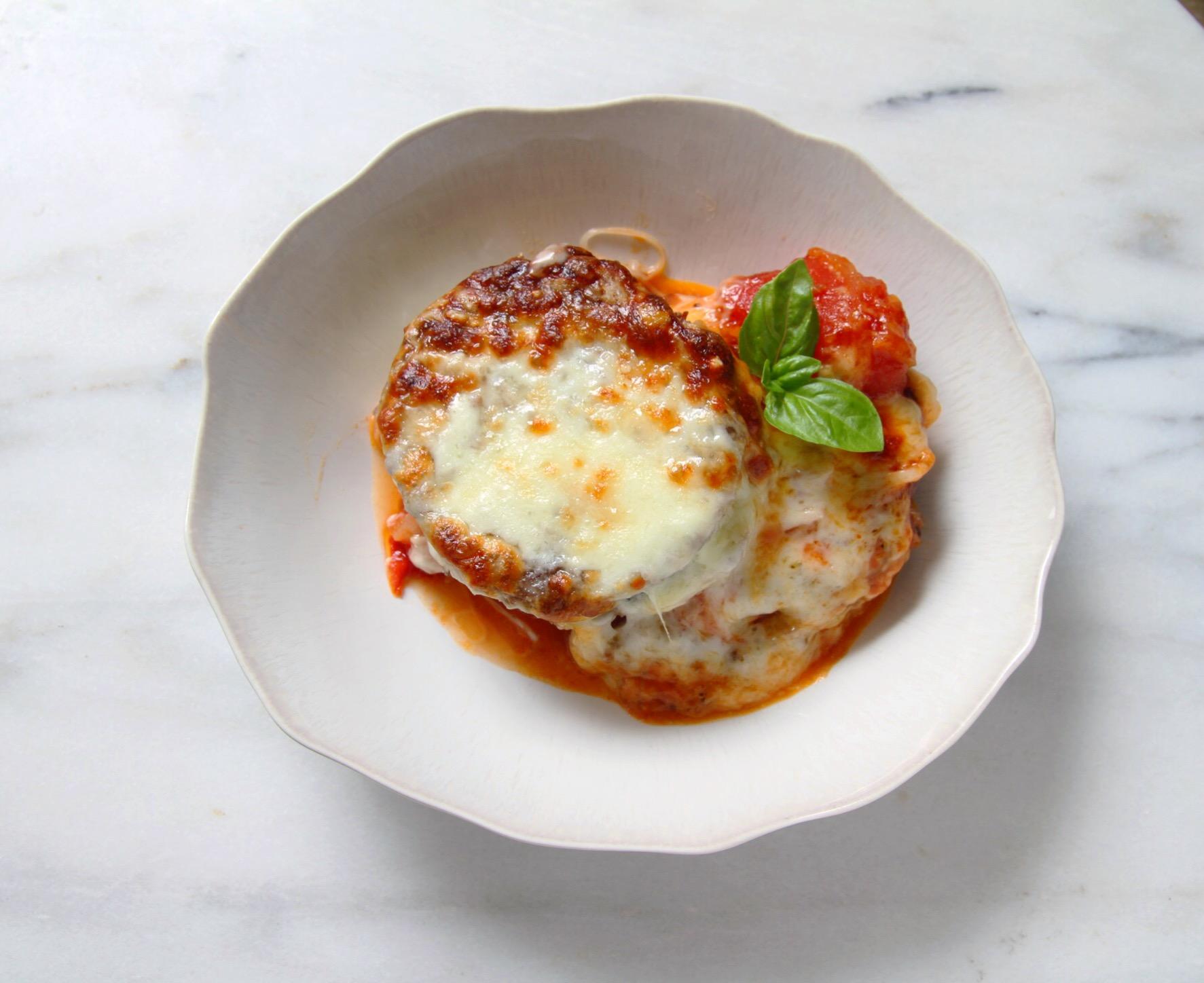 Eggplant Parmesan with homemade tomato sauce.