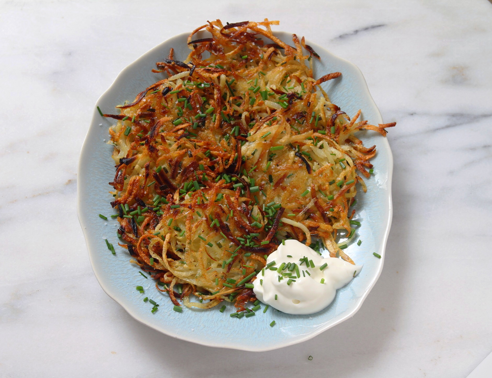 Potato latkes with parsnip, and a side of sour cream for dipping.