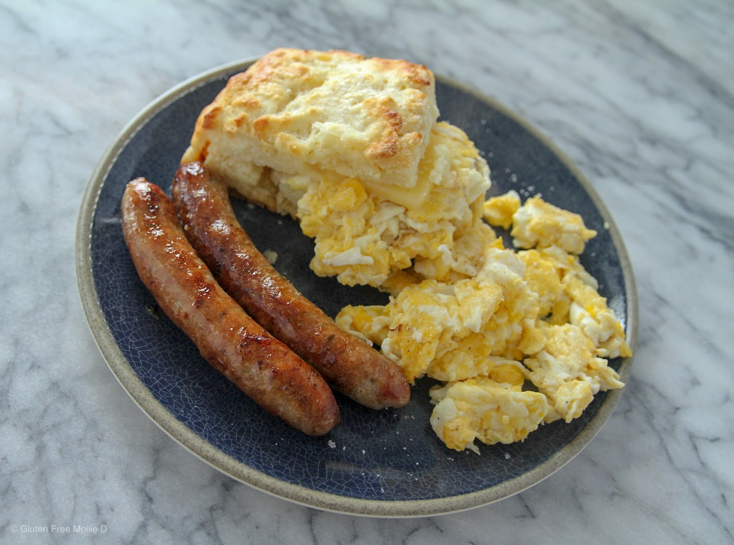 Seth's epic biscuit breakfast. Yes, there's cheddar and scrambled eggs in the biscuit. And those breakfast sausages? YUM.