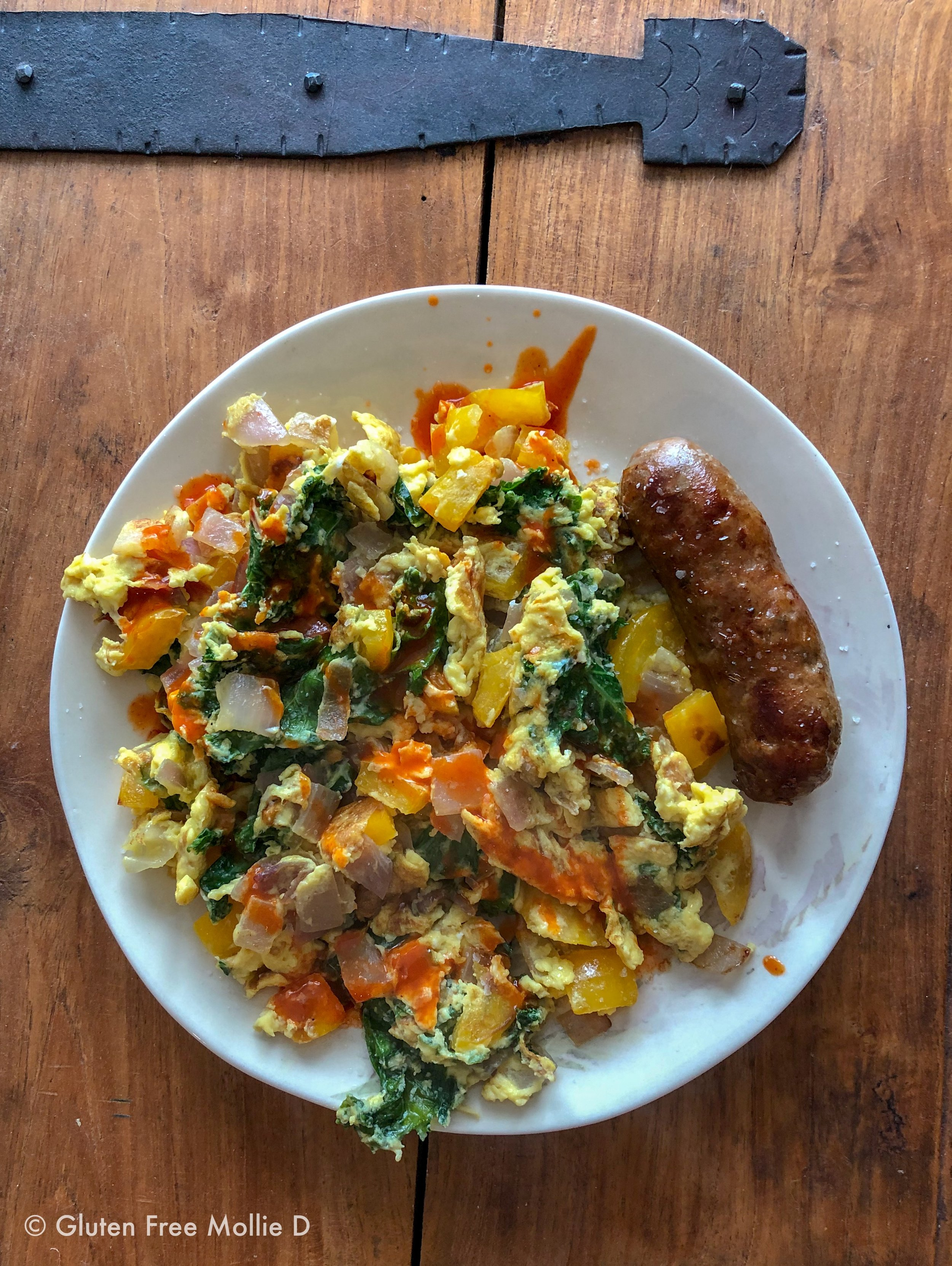 Saturday morning: scrambled eggs with veggies, topped with hot sauce. Side of sausage.