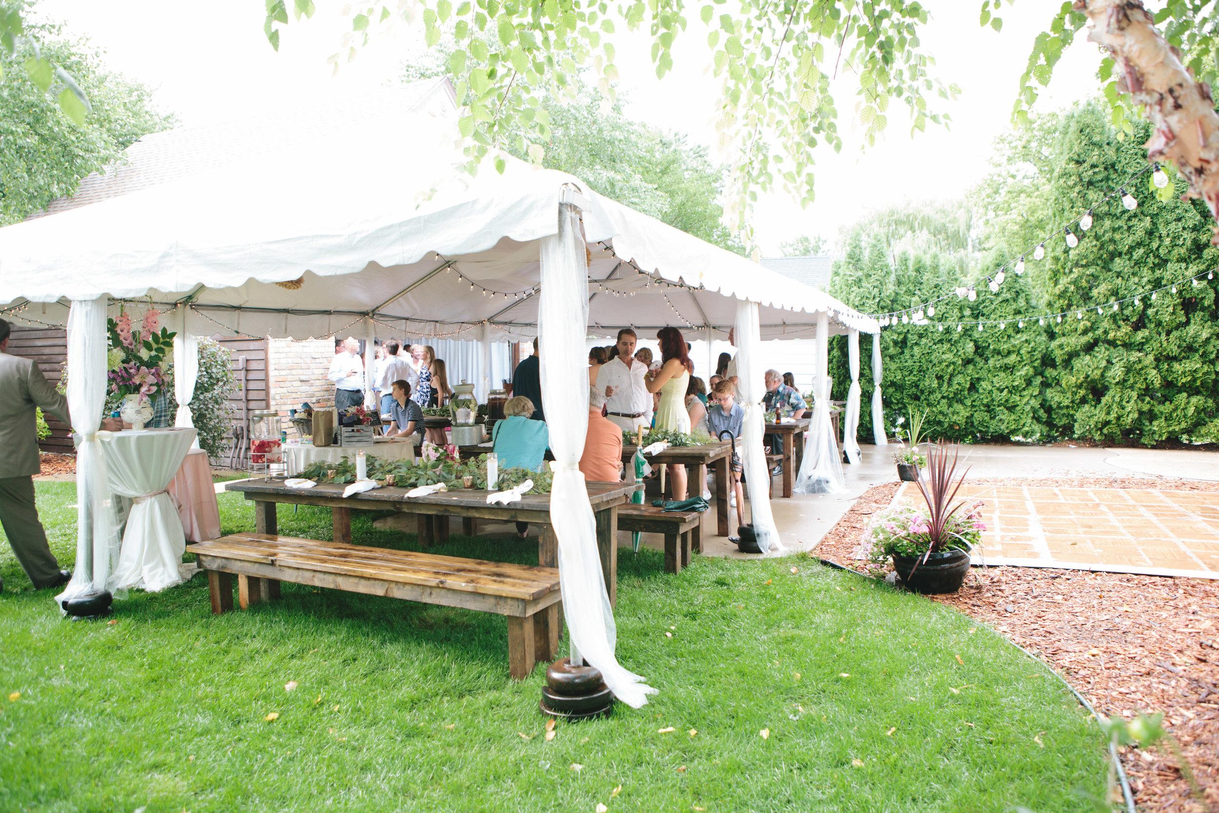 tented wedding reception, prepare for rain on wedding day, wedding string lights, backyard wedding reception inspiration