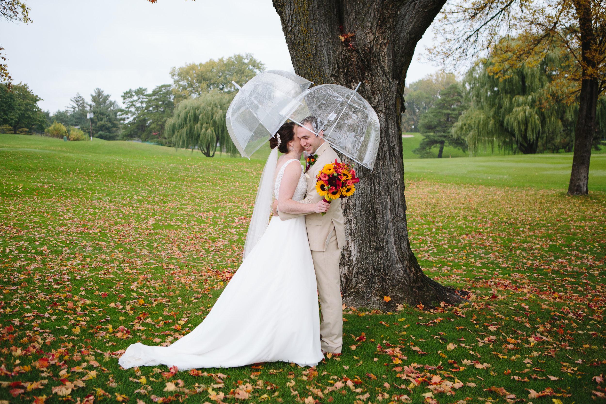 rainy wedding day, fall wedding, October wedding photography, prepare for rain on your wedding day, umbrella wedding photos, golf course wedding photos, candid romantic wedding photos