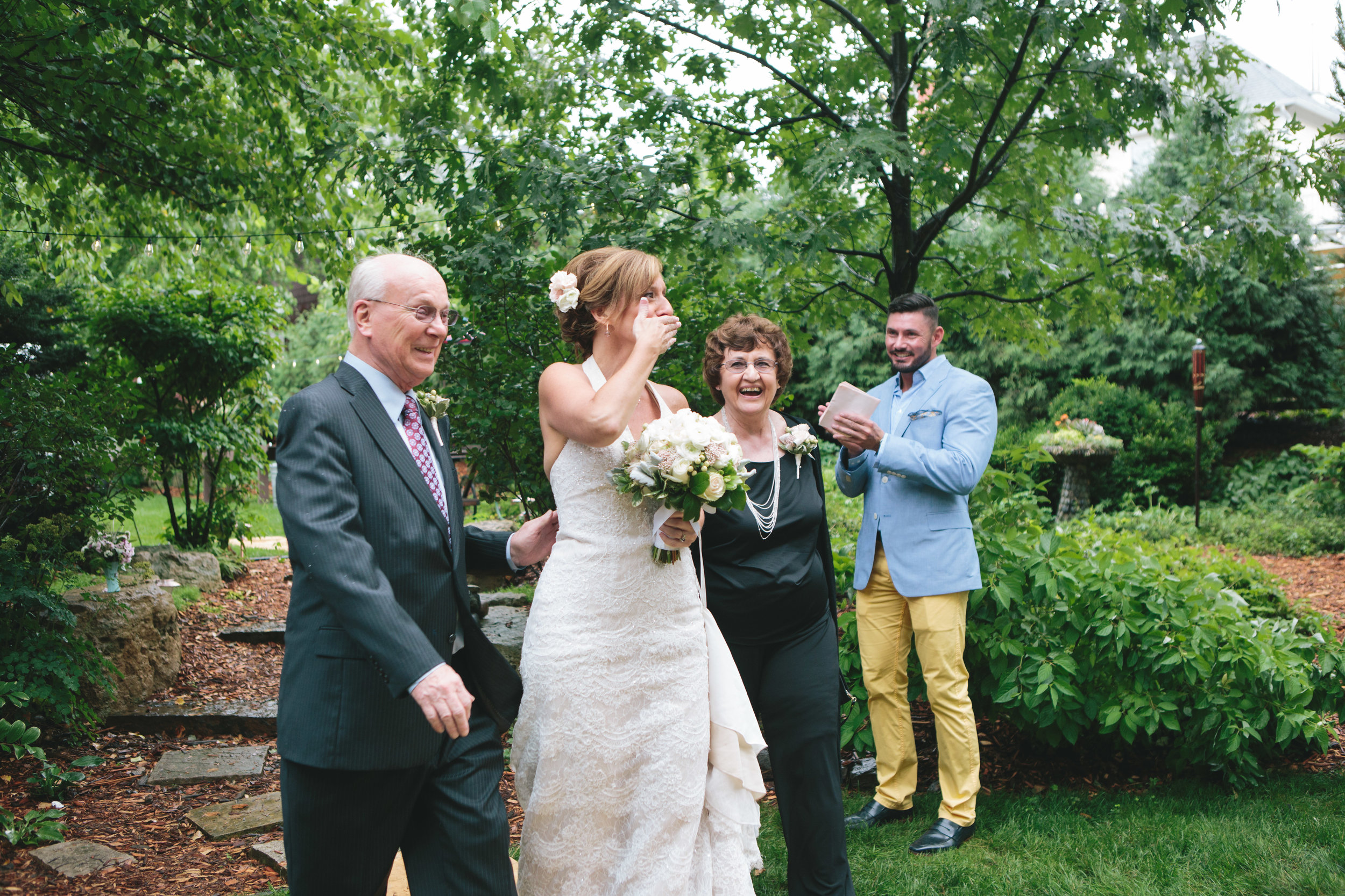 prepare for rain on wedding day, lace wedding dress, backyard wedding inspiration, candid wedding photos