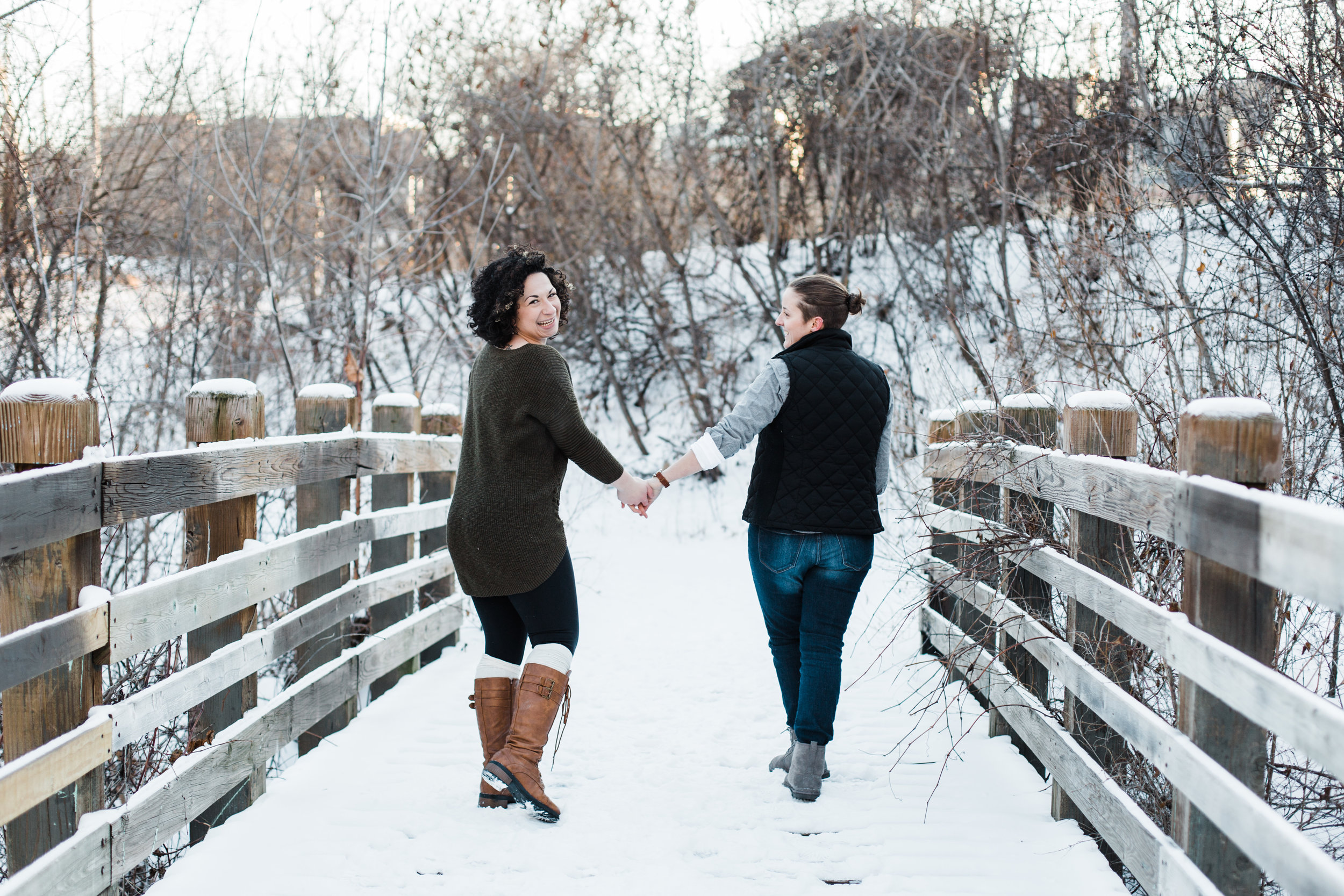 Winter engagement photos, winter bridge engagement photo, LGBTQ engagement photos, fun engagement photos, engagement session inspiration, snowy engagement photos
