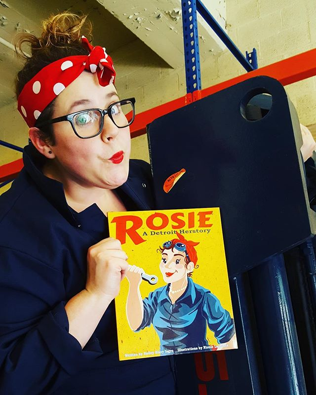 """""""Rosie"""" Kristina knows there isn't a job women can't do. Some days she's riding high on a forklift and others she's marketing the newest books from Wayne State University Press. Whatever she's up to, she's Rosie Strong! . . #womenwithtools #forklift #warehouse #heavyequipment #womenwork #womenworking #rosietheriveter #Rosie #TributeRosie #RosieAdetroitherstory #detroitherstory #detroit #book #youngadultbooks #childrensbook #nonfiction #wsupress @wsupress #womenwarworkers #detroitwoman #reading #author #illistrator #historicaloutfit #yaauthor  #book #tributerosies #michigan #history  #femaleheroes #publisher"""