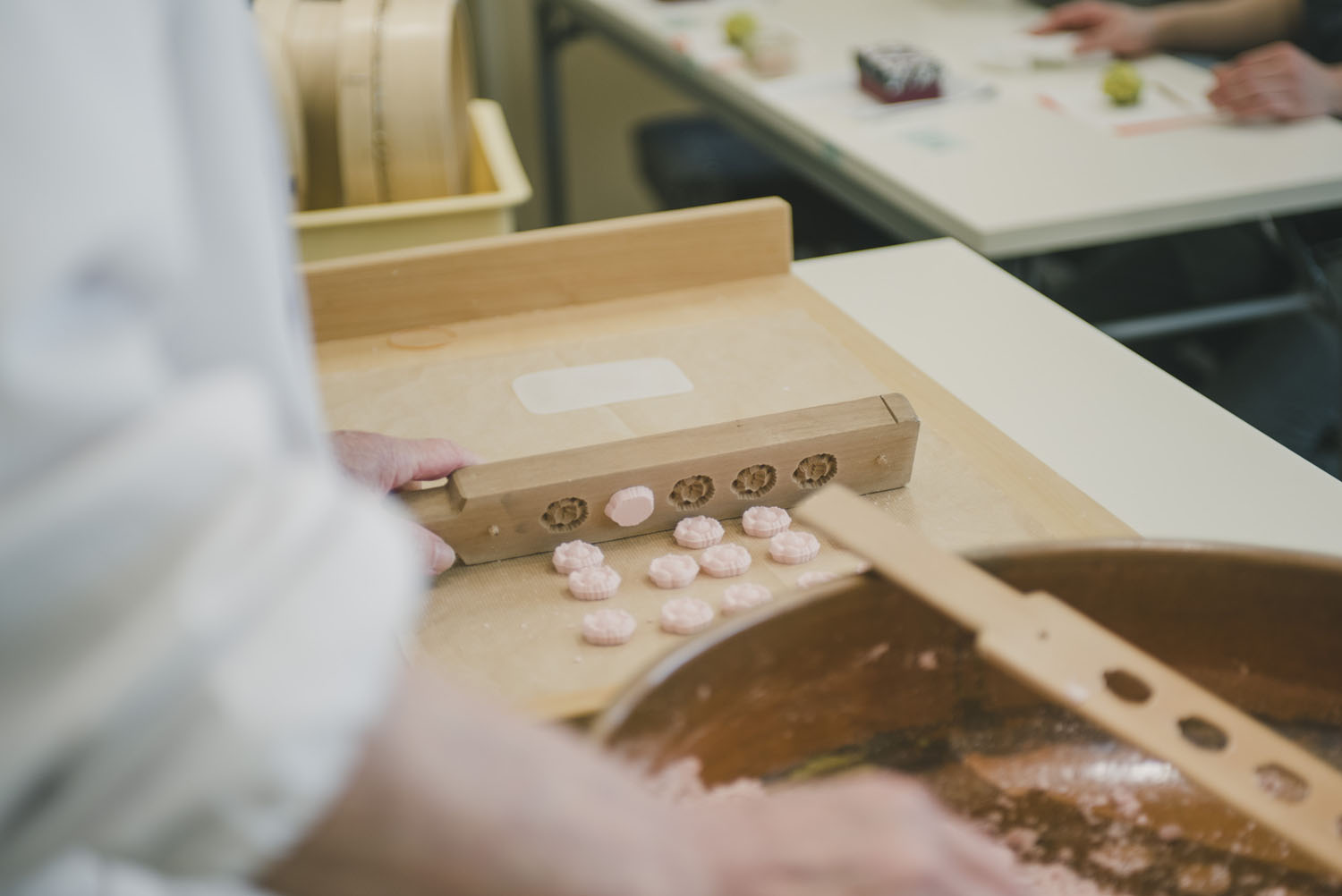 A  wasanbon  demonstration: pressed rice flour and sugar in a carved woodblock.