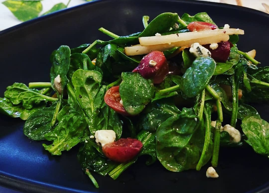 Rise of Spring Salad: baby spinach, bosc pears, grapes, goat cheese, pecans, sunset sherbet terpene infused balsamic vinaigrette dressing