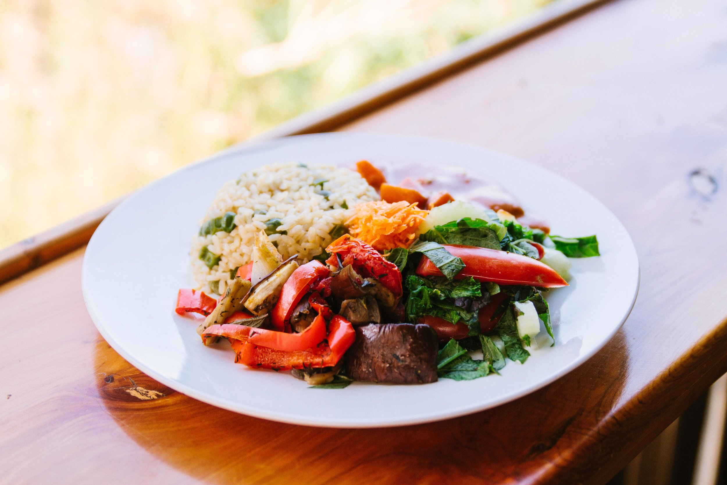 Plate with sauteed vegetables, salad, and grains. Healthy and delicious meals are served at the Discovering Birth Midwifery Retreat July 14-27, 2019 at the Bambu Guest House,Lake Atitlan, Guatemala