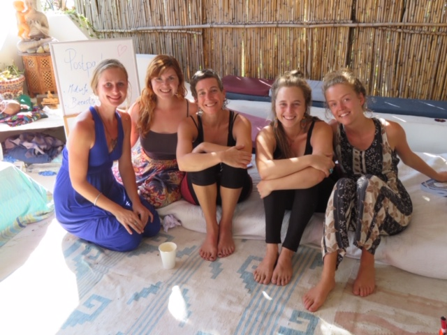 Five smiling women look up at the camera during a break from their lesson on post-partum care of women on the previous Discovering Birth Midwifery Retreat. Upcoming retreat will be held at the Bambu Guest House, Lake Atitlan, Guatemala July 14-27, 2019