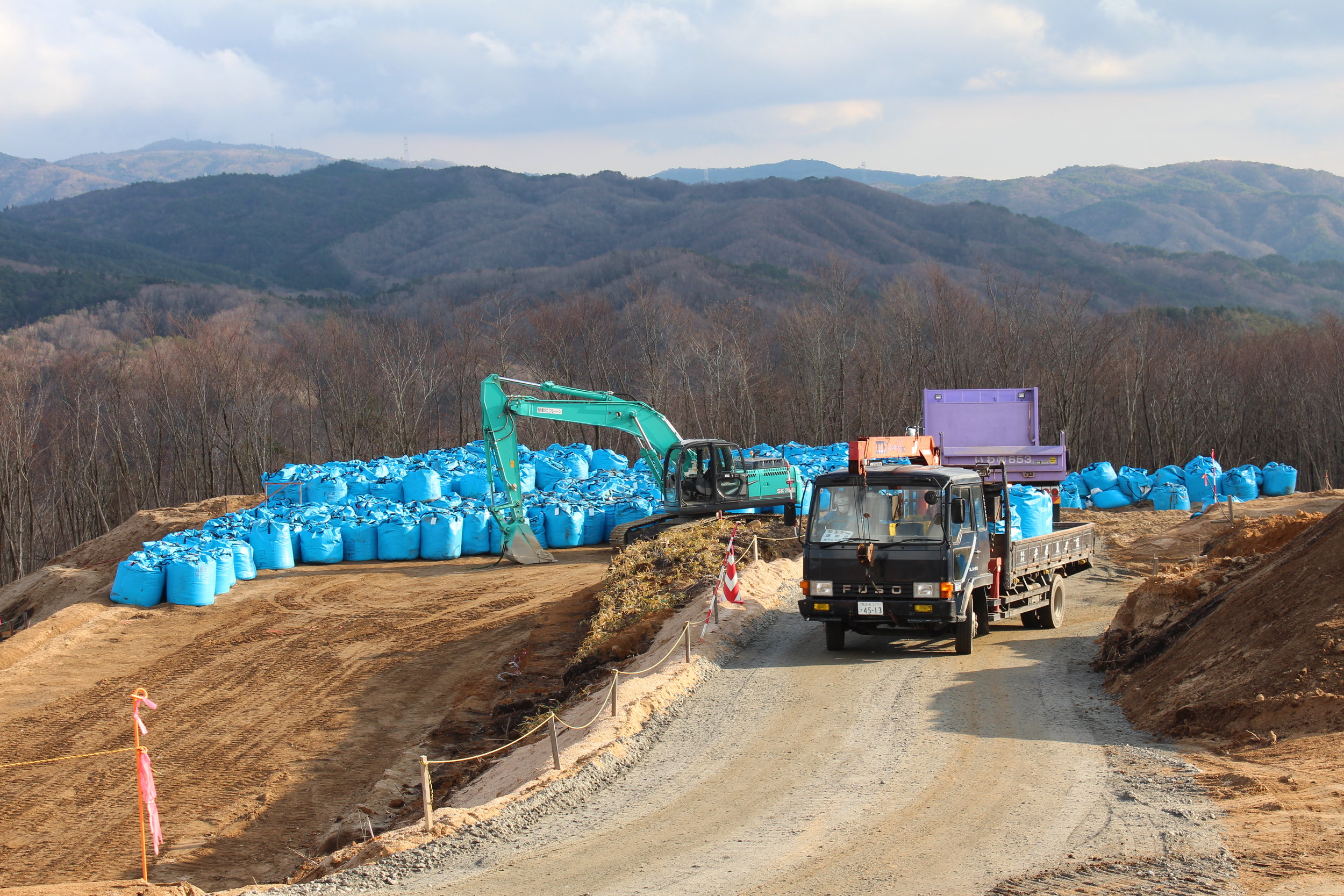 Blue bags of radioactive soil and waste await final resting places.JPG