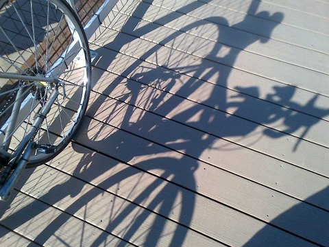 Cool bike shadow on Coney pier Fall 2013.jpg