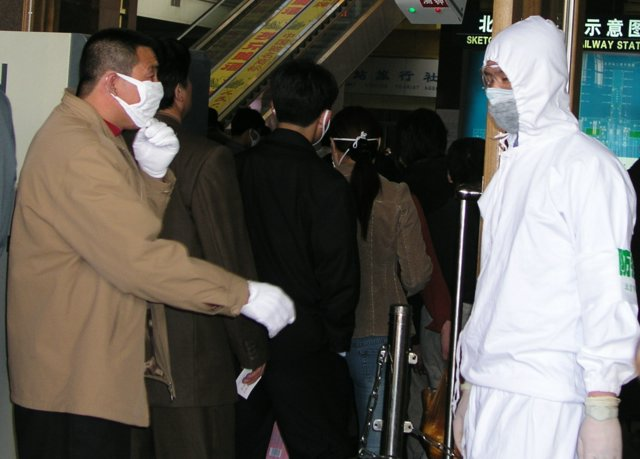 Eventually authorities stopped people fleeing Beijing if they had fevers or symptoms of SARS.11.jpg