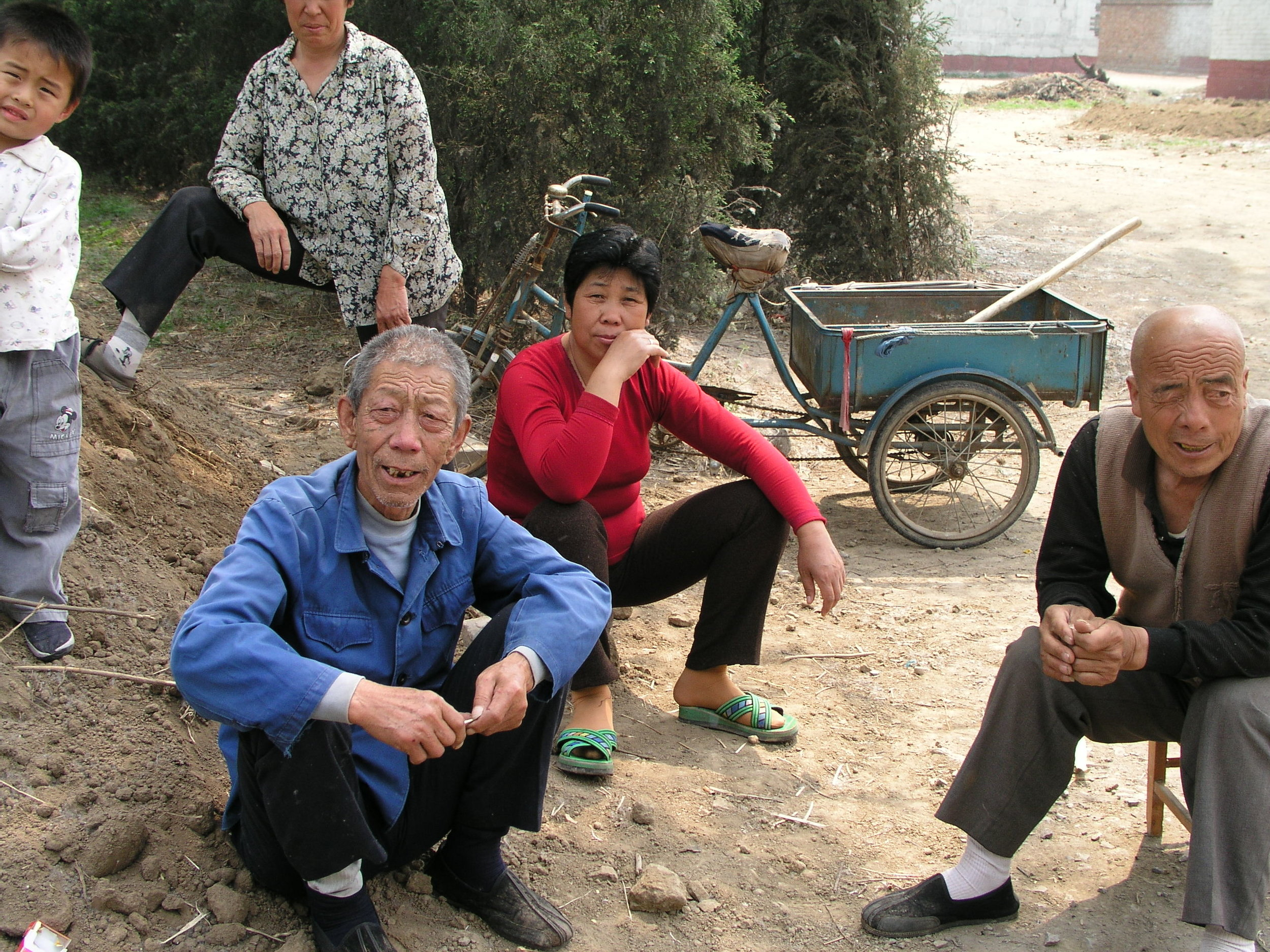 In a village north of Beijing the elders said no outsiders allowed , in hopes of keeping SARS out, even if it hurt their vegetable sales.1.JPG