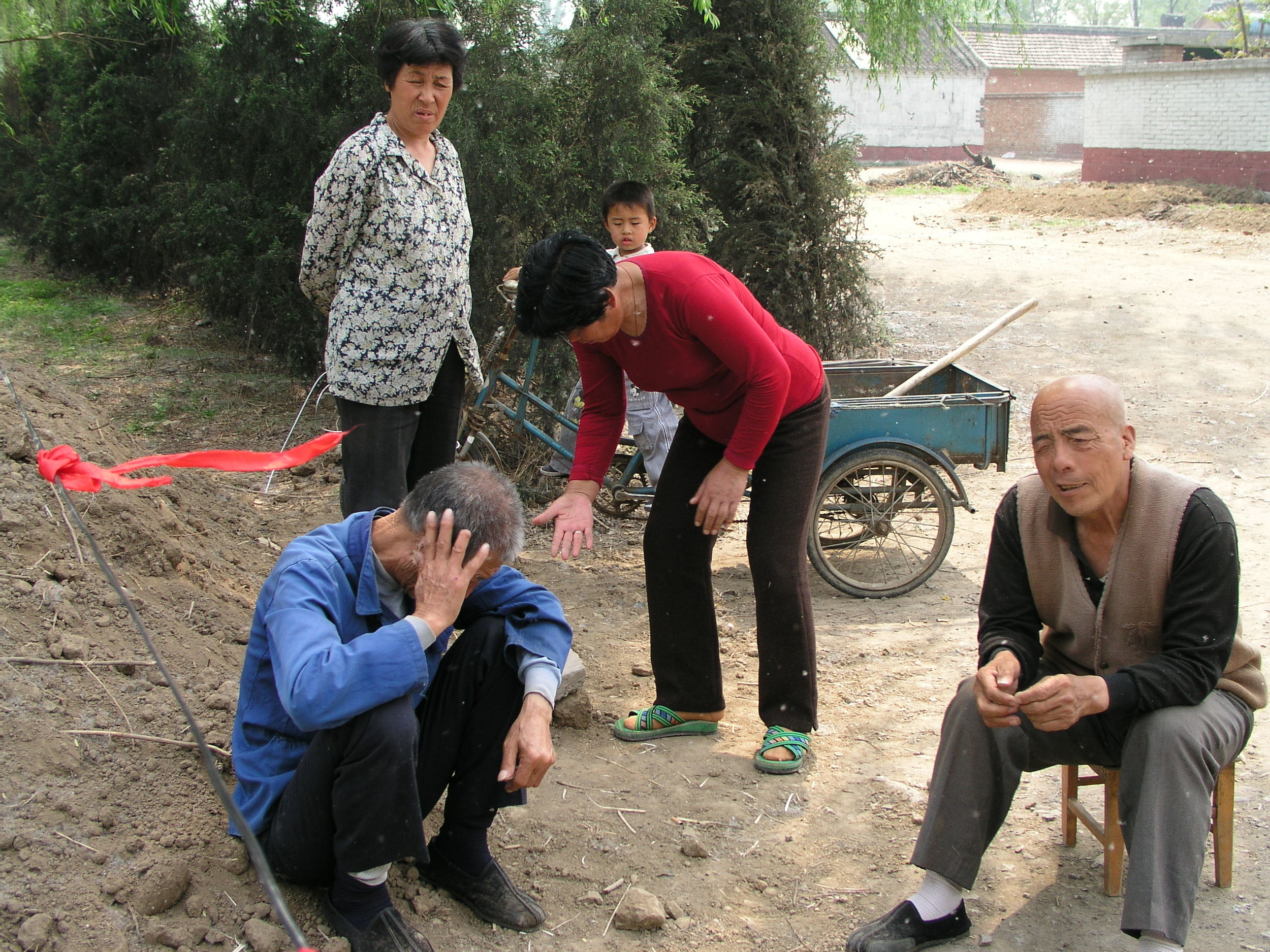 In a village north of Beijing the elders said no outsiders allowed , in hopes of keeping SARS out, even if it hurt their vegetable sales.9.JPG