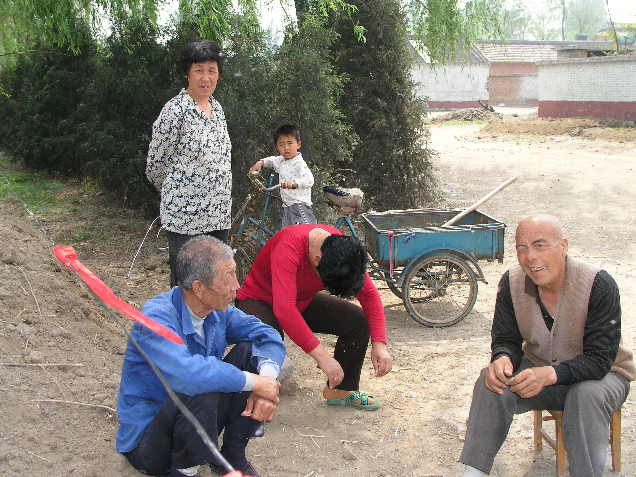 In a village north of Beijing the elders said no outsiders allowed , in hopes of keeping SARS out, even if it hurt their vegetable sales.10.JPG