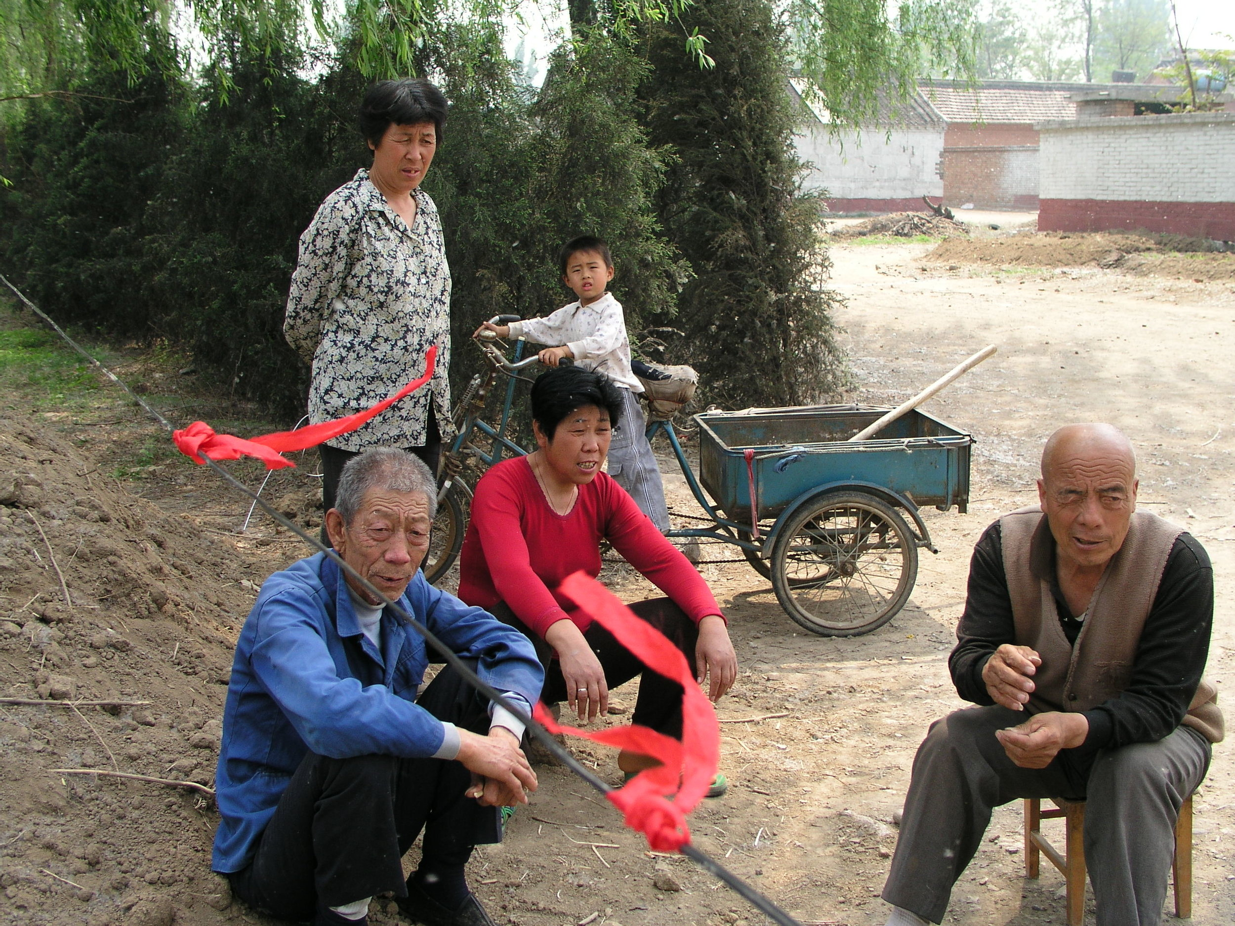 In a village north of Beijing the elders said no outsiders allowed , in hopes of keeping SARS out, even if it hurt their vegetable sales.11.JPG
