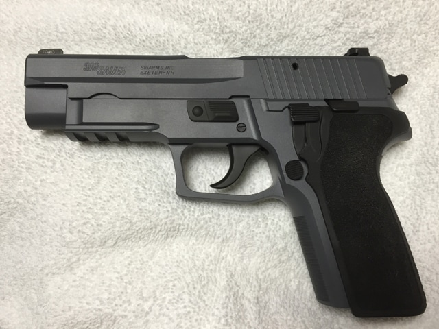 A P226 slide on our 229, Cerakoted Sig Dark Gray by MSG limited, modified E2 grip kit.