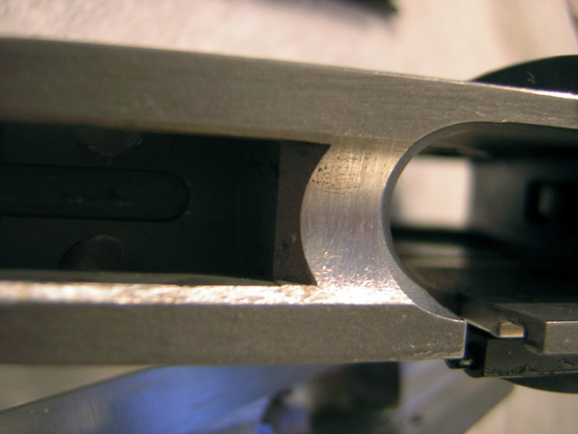 "A contribution by a customer who is using our barrel seat cutter to build a Stealth Arms aluminum 80%  ""It cut the aluminum like butter. That is just ""dirt"" on the barrel seat - just the way the photo caught it – the cut looks almost polished.  PS – (not trusting you) I put .002 shim between the frame and your jig and made the barrel seat cut. Measured it up and……. Yep - needed .002 more. Put it back in your jig and re-cut – Perfect! Makes cutting the barrel a whole lot easier. Thanks"""
