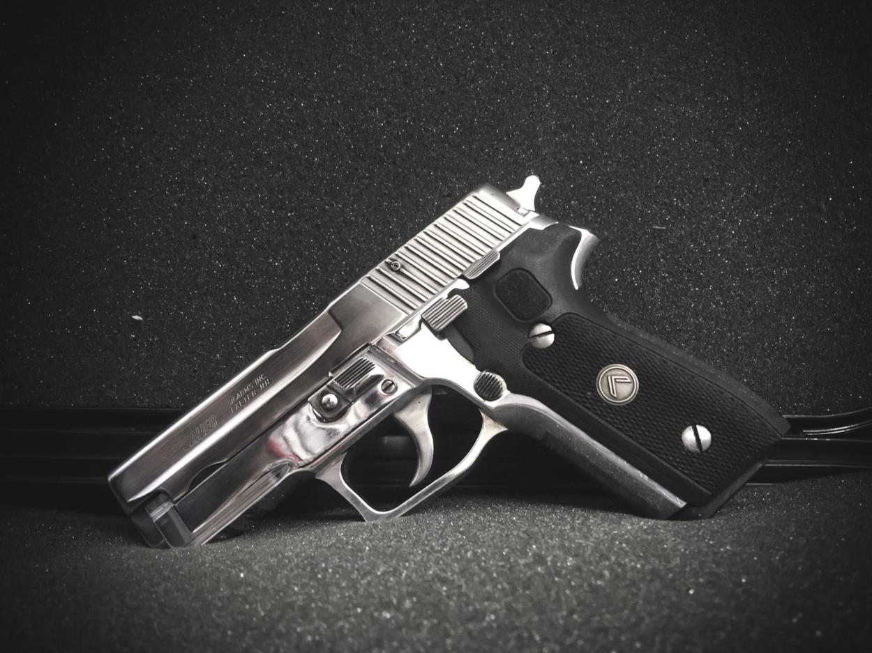 Super nice high polish P228 slide on a P229 railed frame.