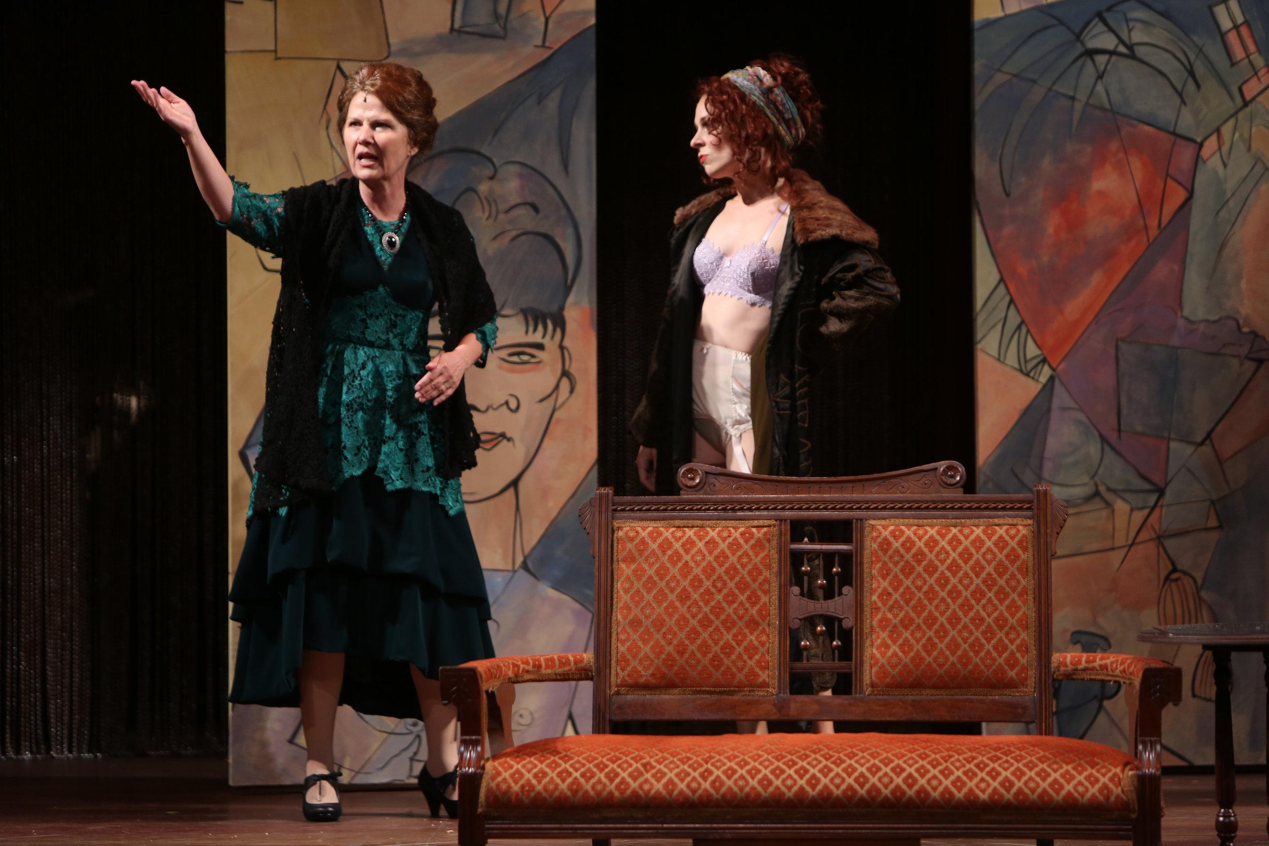 Kost and Frau Schneider (Mary Gordon Murray).
