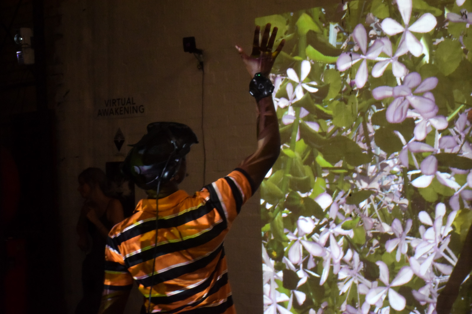 """People interacting with """"I Never Promised you a Garden"""" VR Installation by Melanie Courtinat"""