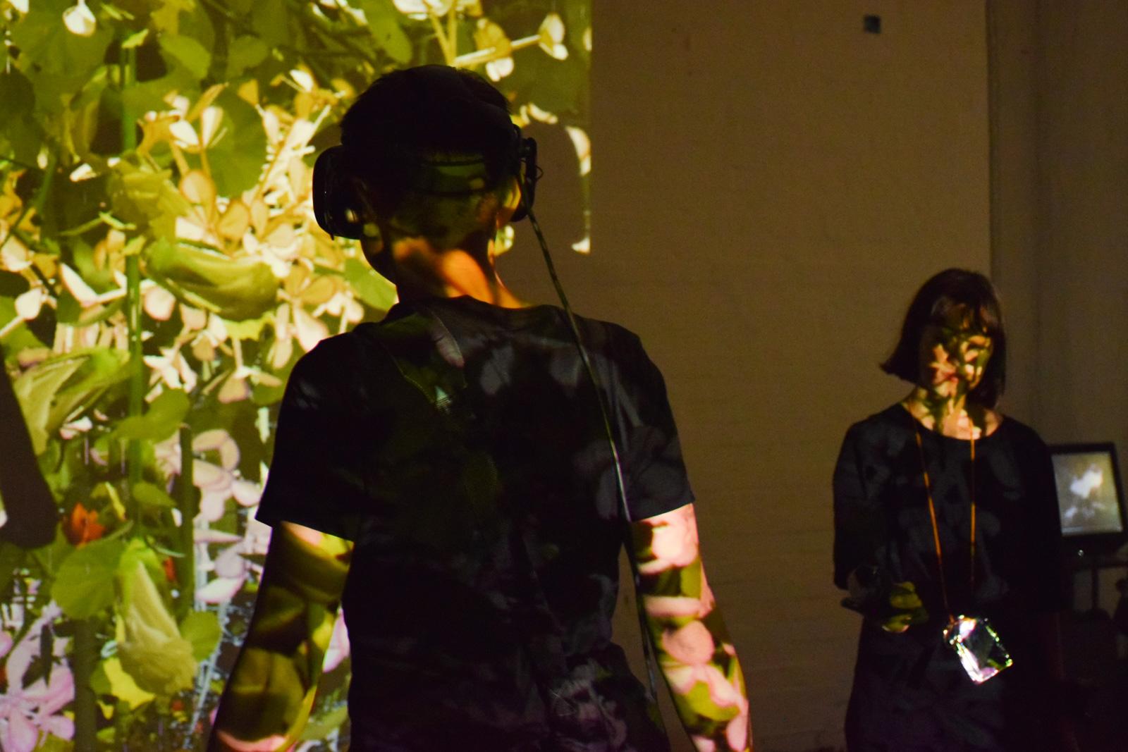 Artist Melanie Courtinat behind her installation