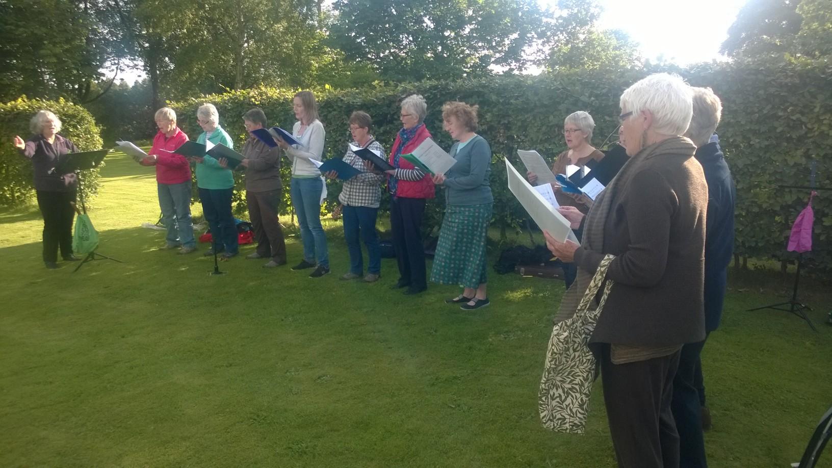 The Bridge Singers in the sunshine at Felton Park
