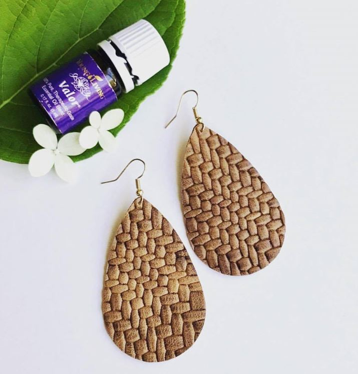 Did you know you can use W E as diffuser earrings? Simply place a drop or two of your favorite oil on the back of your earrings. Why? The leather will keep the scent longer than your skin, and you get the benefits of wearing an oil all day.