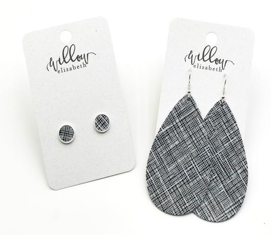 Go Grey  - If you're a lover of neutral+sparkle, you have to check out the new Graphite leather! We love it in a stud, all the way up through the XL!