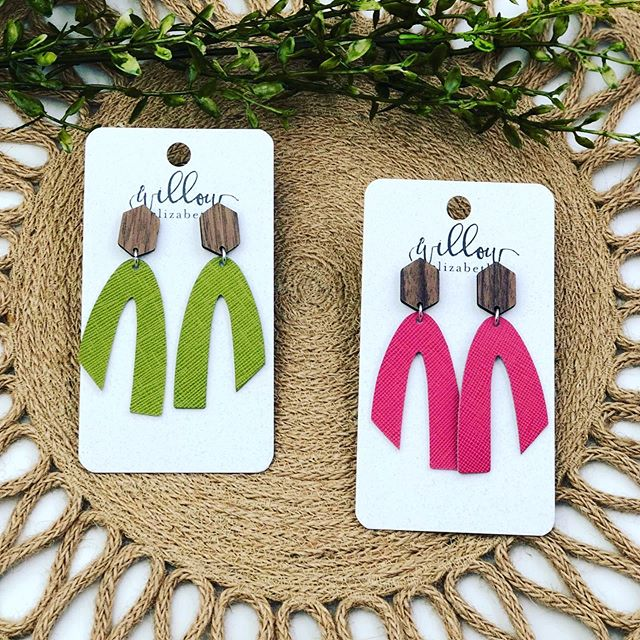 Our new shape, The Ursula, is NOW available in 3 bold+bright colors! 💗 . . . #shoplocal #shopsmall #shopsmallbusiness #leatherearrings #ootd #summerfashion #lightweight #handmade #lakeerieleather #lakeerieoriginalleather #accessories #jewelry #earrings  #custom #newarrivals #wood #pink #green #turquoise