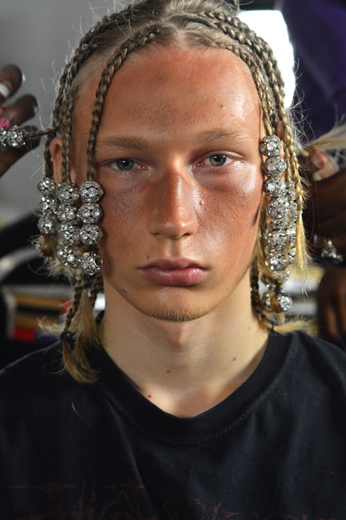 !! DISCOBALLSINHAIR !!      Backstage with  Hood by Air  #NYFW. Hands down the  most interesting backstage scene I have yet to see . Hair stylist   Amy Farid   worked with   Bumble and Bumble   to create four looks - the wedding look, the Venus and Serena look, the Forest Gump look and the grunge dreadlocks look.   You can guess which one inspired look above.    *sshwoop*    The looks are an extension of what Hood by Air represents - a unisex nation. The notion that there is nothing women can't do that men can do and vise versa.   Quite the statement, but they caught my attention.   And.. the disco balls are just re-dic.    Images Cult of Pretty    -Kristin
