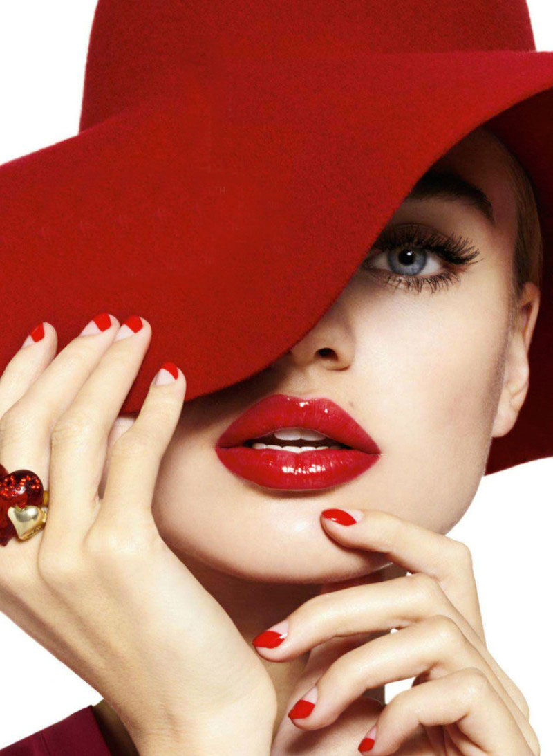If you feel like a red nail is just too much, hey hey, you can  do half a red nail.     Image: Cosmopolitan; Manicure by Tracylee for Sally Hansen