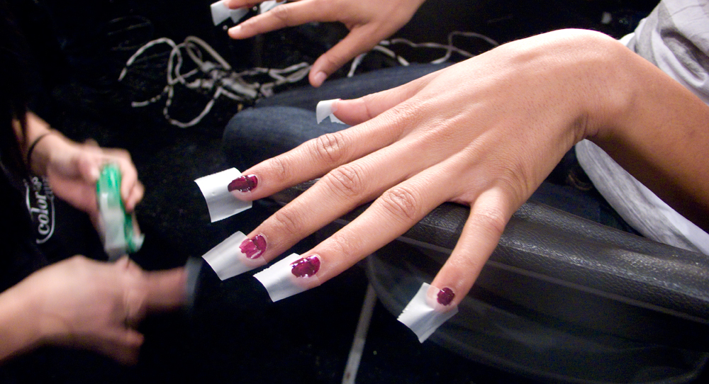 The   Color Club   nail team created an awesome split color nail for   L.A.M.B FW12   with  this really expensive professional masking tool .   : ) Try it!    Image - Cult of Pretty