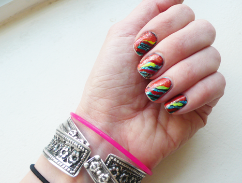 """I just went crazy last night like a 4th grader with some puffy paint and a poor, poor My Little Pony who found himself on the wrong craft table at the wrong time.   Here's how this went down:   - Base is  Incoco Urban Jungle  blue glitter zebra nail """"stickers"""" - Rainbow madness is random fluorescent pink, yellow and  Revlon Siren  (coral) - Topcoat is Deborah Lippman gold glitter from this  Juicy Couture set    So … sometimes it's just about playing and going nuts, I guess.   If you have any respect for me after this, did want to let you know you can now shop almost all my product recommendations in one place over on my     Currently Obsessed.me page !     The site is still invite-only but I have about 100 you can use, just enter  Holier_than_NowObsessed  when you're bounced to the login page.   There are fashion finds on there too from my other blog  Holier than Now ."""