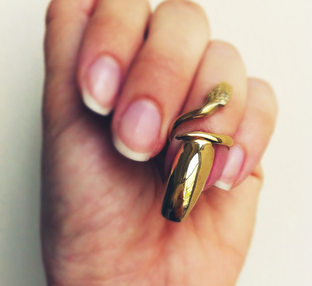 I've yet to find the perfect solid gold nail polish so  I bought  a gold fingernail .