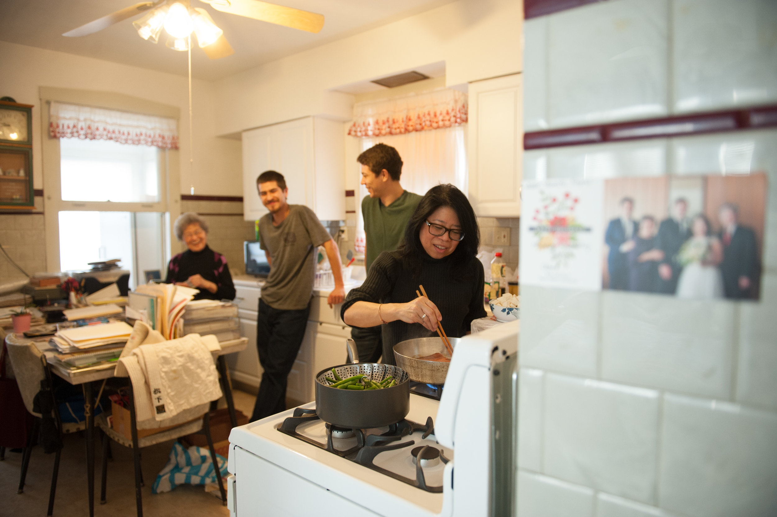 Elaine, Josh, Sam, and Fumiko cook a meal together in Fumiko's apartment.