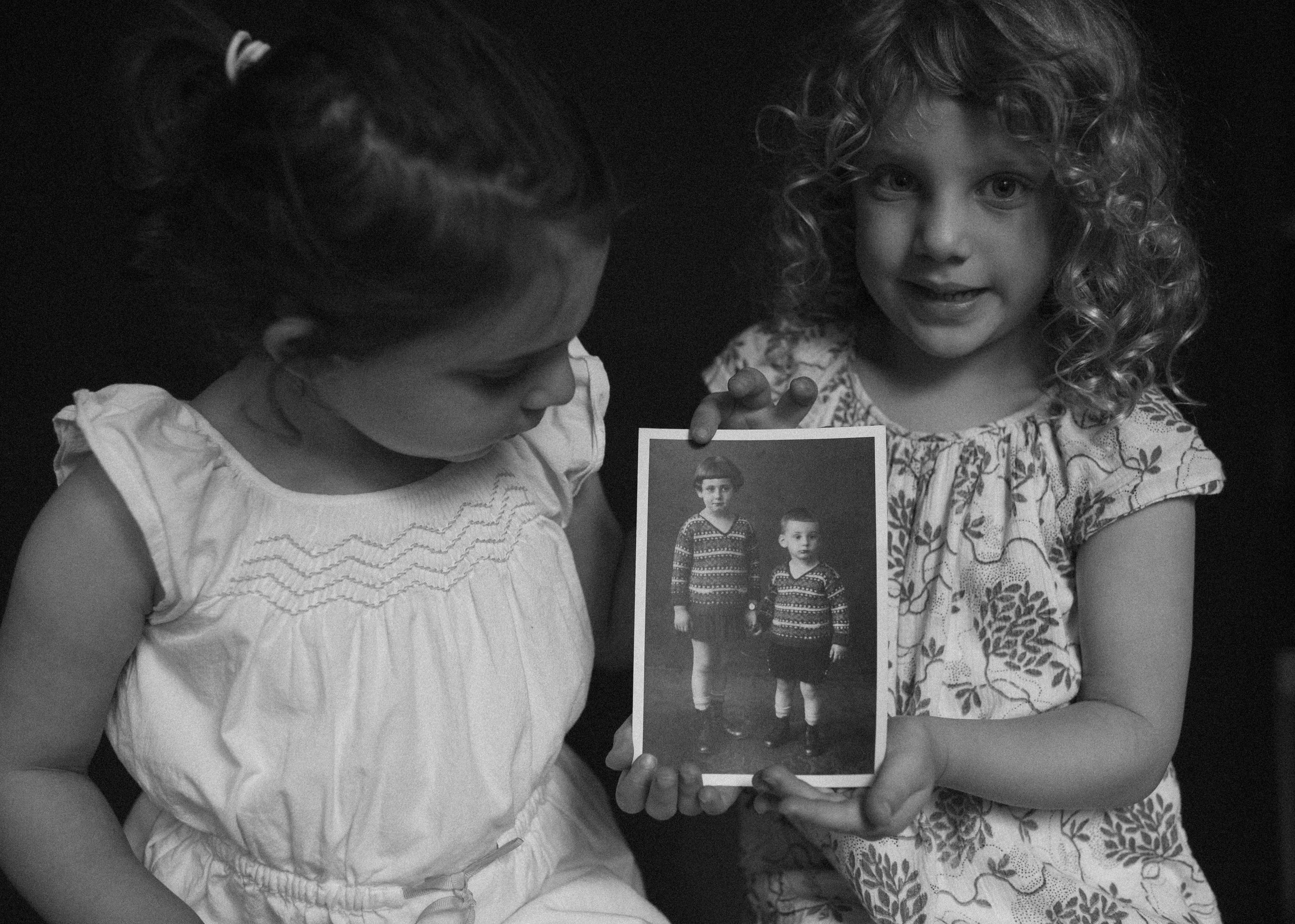 Naomi and Clara hold a picture of Ulrich and Gerda.