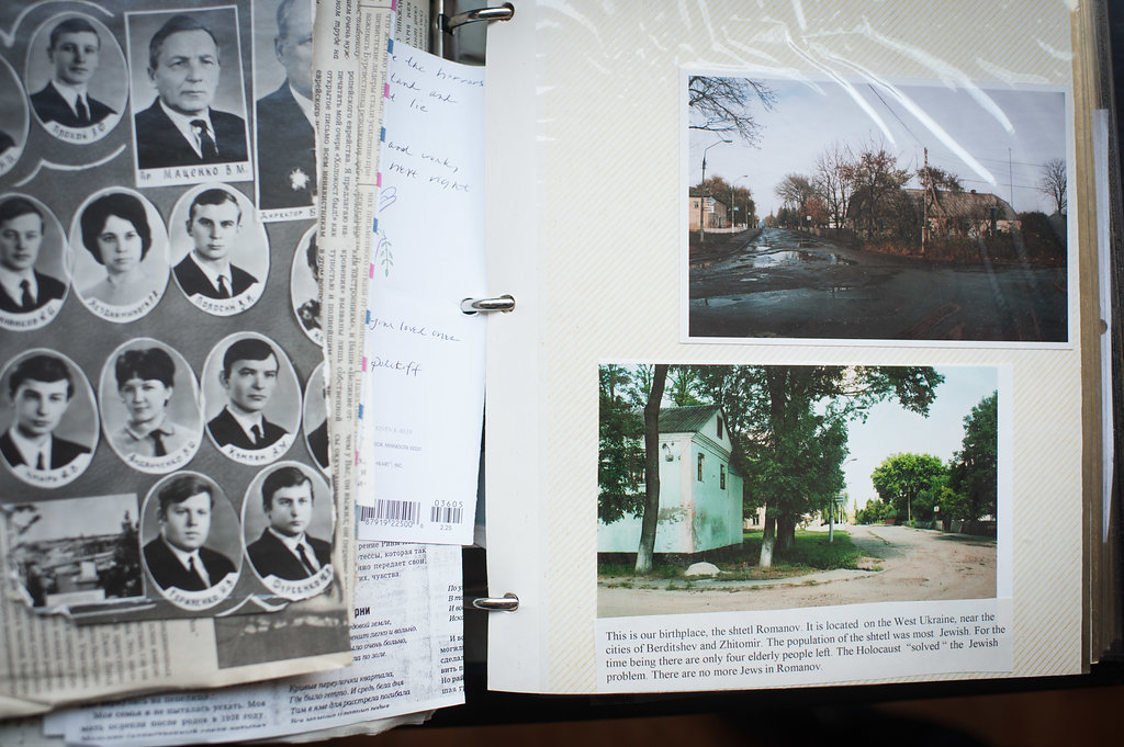 A scrapbook made by Elena's mother. Pictures of the town of Romanov.
