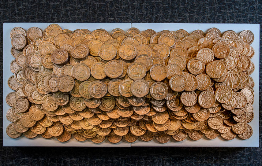 In You We Trust    floor installation. Terra Cotta, gold paint    In You we Trust  is a collaborative project between Jen Rose and Marian Lefeld where we made 2,000 golden clay medallions to symbolize the 2,000 children trafficked on the streets of Dallas each year.
