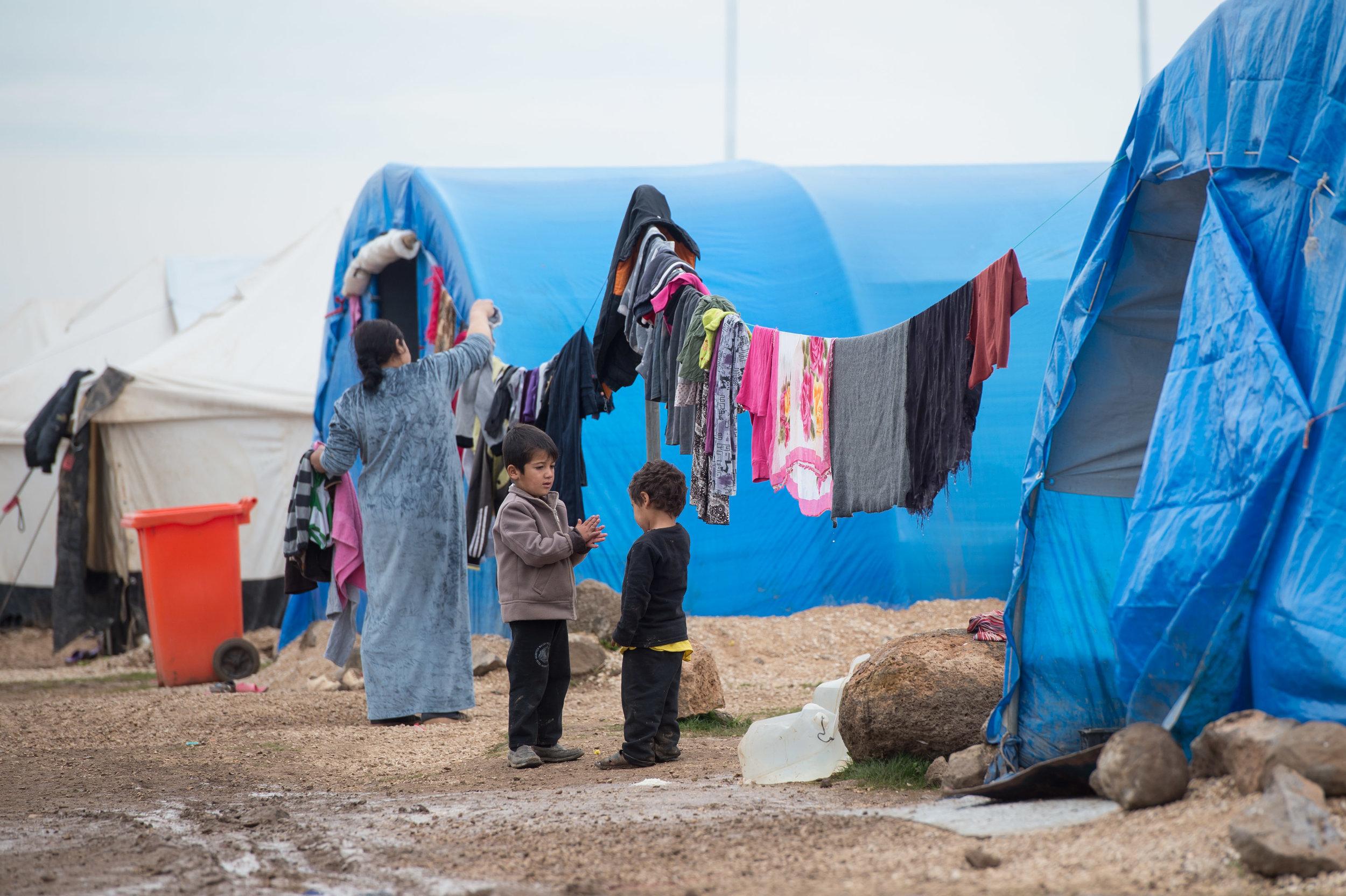 children play in refugee camp GOOD.jpg