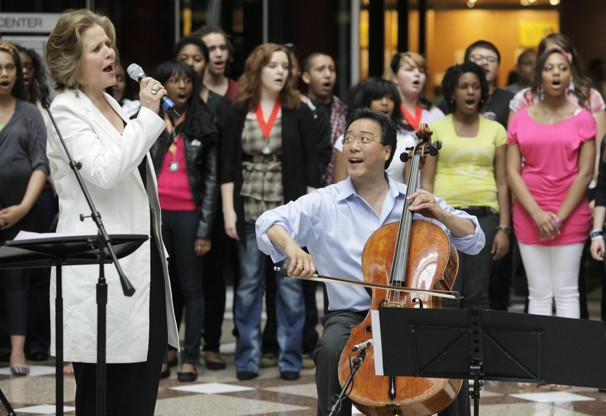 """Yo-Yo Ma and Renée Fleming performing Joe Clark's arrangement of """"America the Beautiful"""" in a flash mob at the James R. Thompson Center. (2012)"""