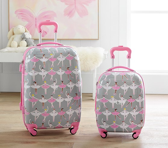 These Pottery Barn Kids hard case suitcases are my new favorites. Buy the big one.