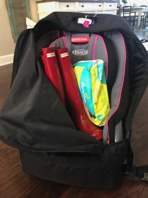 In my JL Childress car seat bag, I have a full sized toddler seat, a large pair of Hunter boots and two packs of diapers with room to spare...and it all flies free!