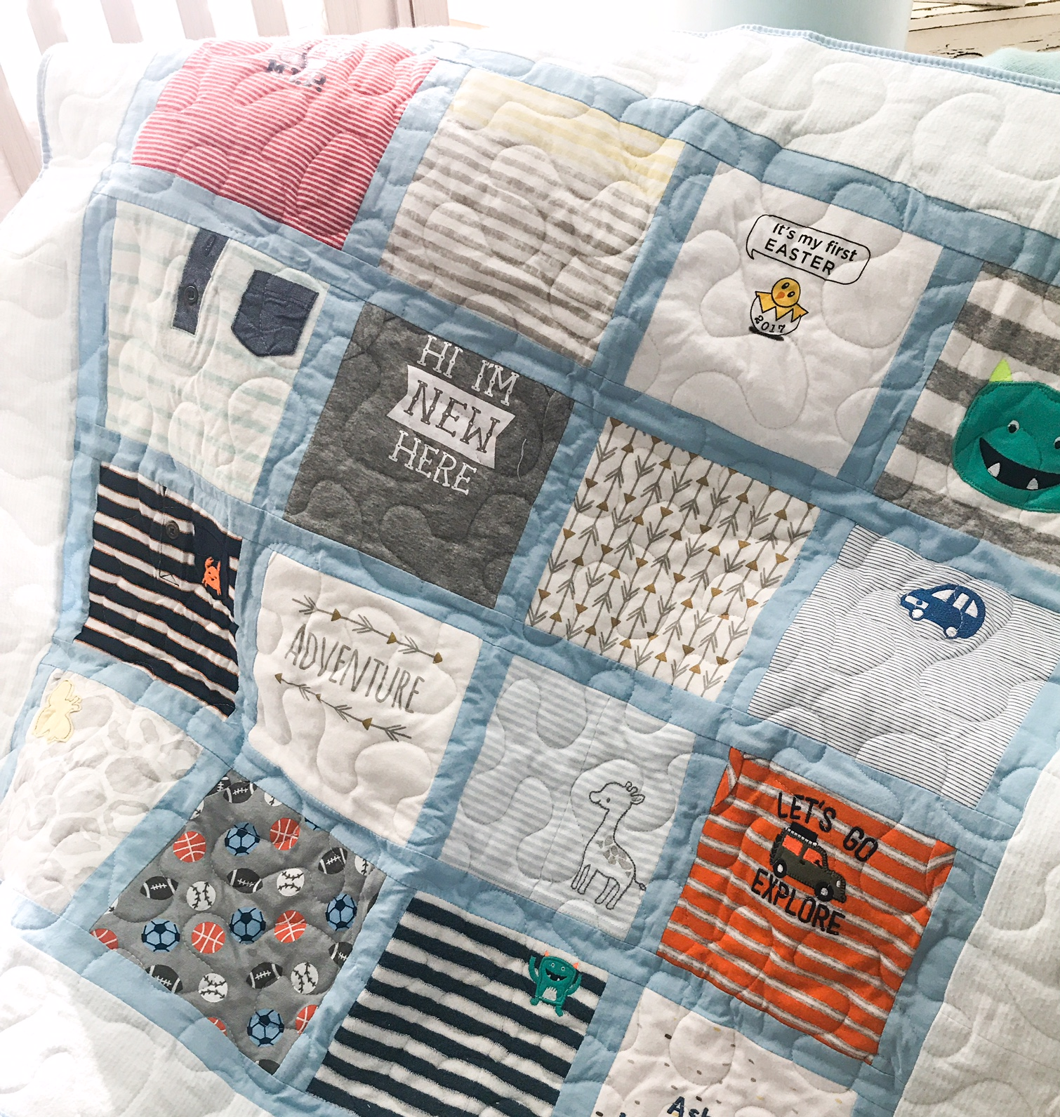 The quilt I had made for our birth mother. I saved many of the onesies I would normally donate and made a 16 square quilt as a keepsake. I will make one for myself as well.
